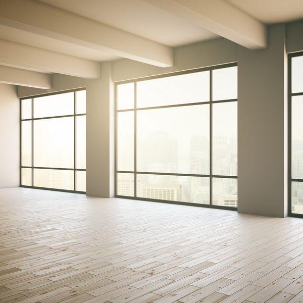Empty light loft interior with wooden floor three panoramic windows and sunlight. 3D Render